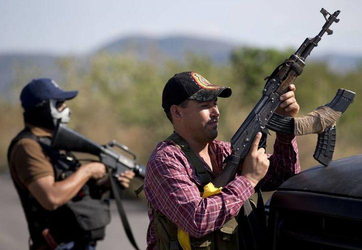 Autodefensas están en Uruapan además de la Policía Federal. (Archivo/Agencias)
