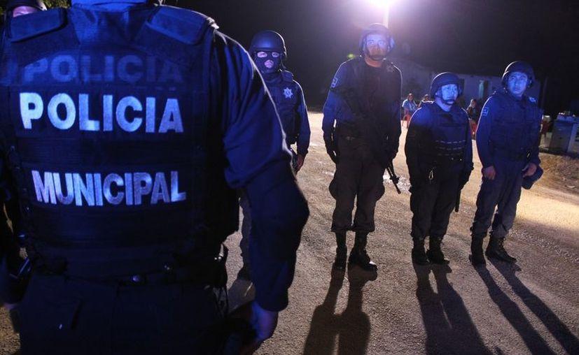 La importancia de dichas credenciales es que se asimilan como licencias individuales y respaldan a los oficiales en la portación del uso de armas de fuego. (Juan Carlos Gómez/SIPSE)