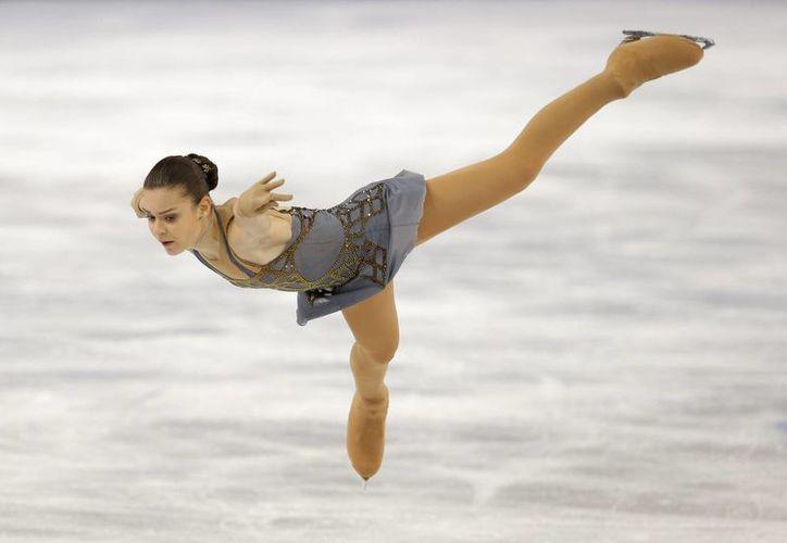 Este es el día más feliz de mi vida, dijo Sotnikova, de 17 años, campeona de patinaje artístico en Sochi. (Agencias)