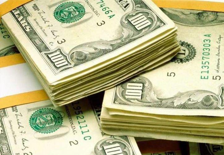 En ventanillas de Santander y Bancomer el dólar se cotiza en 16.22 pesos. (Archivo/SIPSE)
