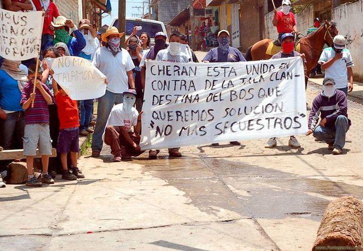 Desde hace 3 años, Cherán, uno de los 113 municipios de Michoacán se rige por sus propias 'leyes' y les va bien. (Archivo/purepecha.mx)