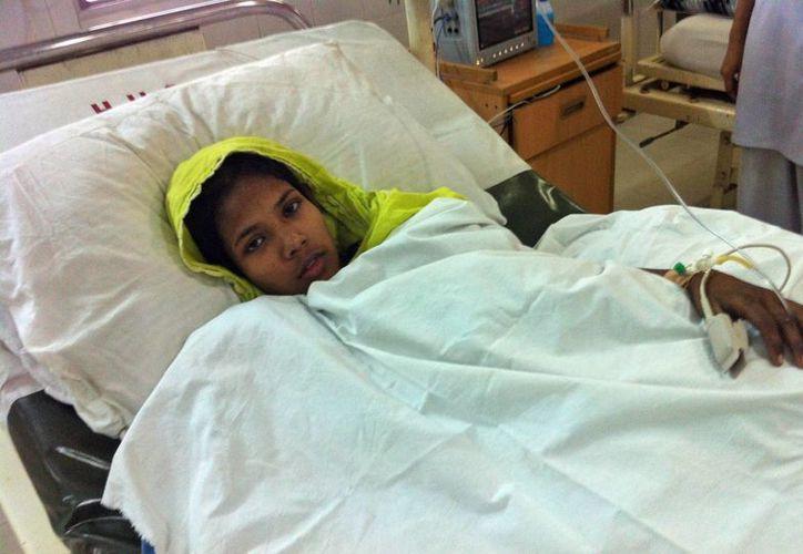 Varios fotógrafos fueron autorizados a visitar el hospital para tomar fotos de Begum. (Agencias)