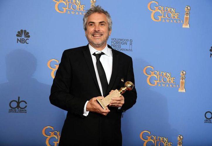 Alfonso Cuarón demostró el valor de su trabajo al convertirse en el primer latinoamericano en recibir un Globo de Oro a Mejor Director. (Agencias)
