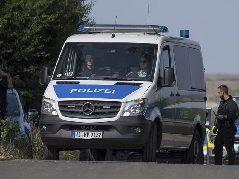 Police officers block a road near Wiesbaden, Germany, Thursday,. The body of the 14-year-old girl, who had been missing since May 22, was found Wednesday on the outskirts of Wiesbaden.