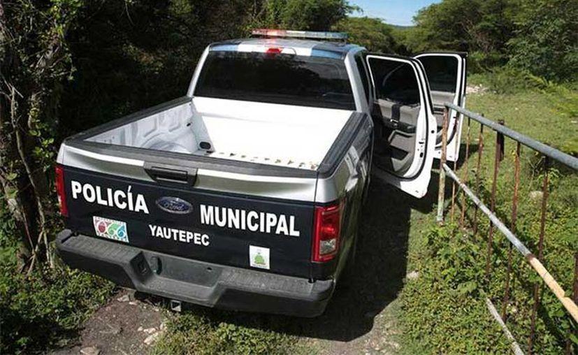 Los tres hombres, quienes presuntamente se dedicaban al robo de ganado, fueron torturados y ejecutados con arma de fuego. (Pedro Tonantzin Sánchez/Excelsior)
