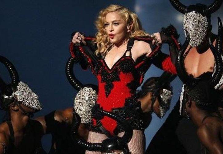 Luego de anunciar que reprogramó sus conciertos de agosto y septiembre, la cantante Madonna, prometió que 'valdrá la pena esperar por este espectáculo'. (AP)