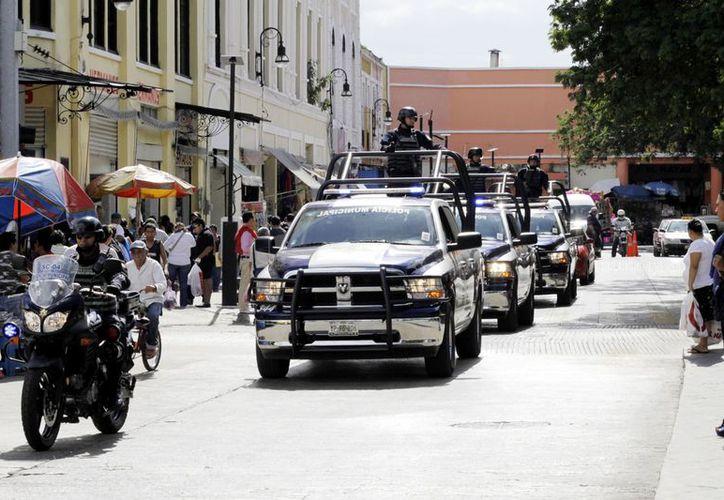 La vigilancia se ha incrementado en las principales calles de Mérida. (Milenio Novedades)