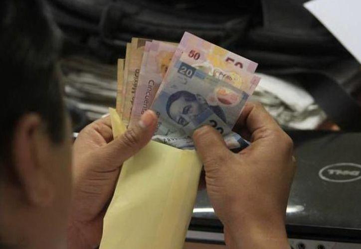 El delegado federal del Trabajo y Previsión Social dijo que el 20 se considera como tardío para el pago del aguinaldo. (Redacción/SIPSE)