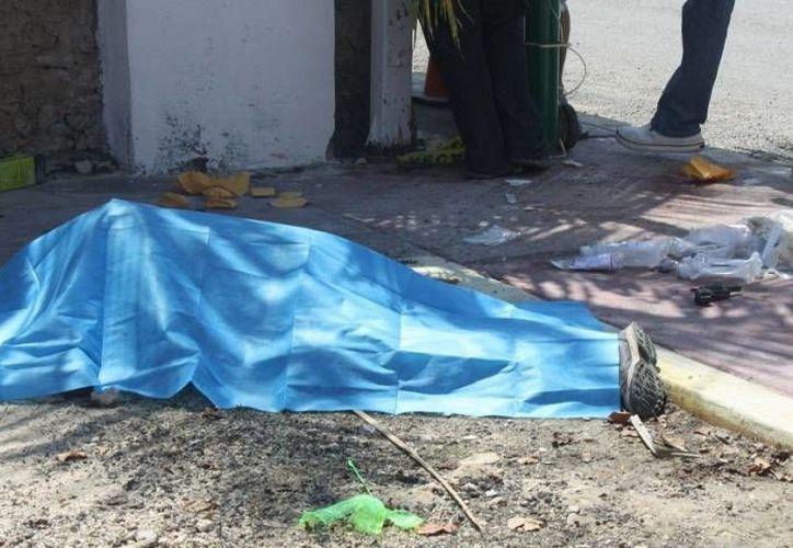 El cuerpo del suicida, tras balear a su expareja. (Archivo/SIPSE)