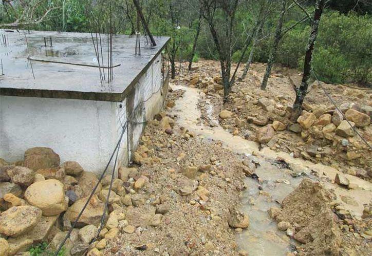 Al menos 400 habitantes afectados y 100 casas anegadas han dejado las intensas lluvias. (Patricia Briseño/Excélsior).