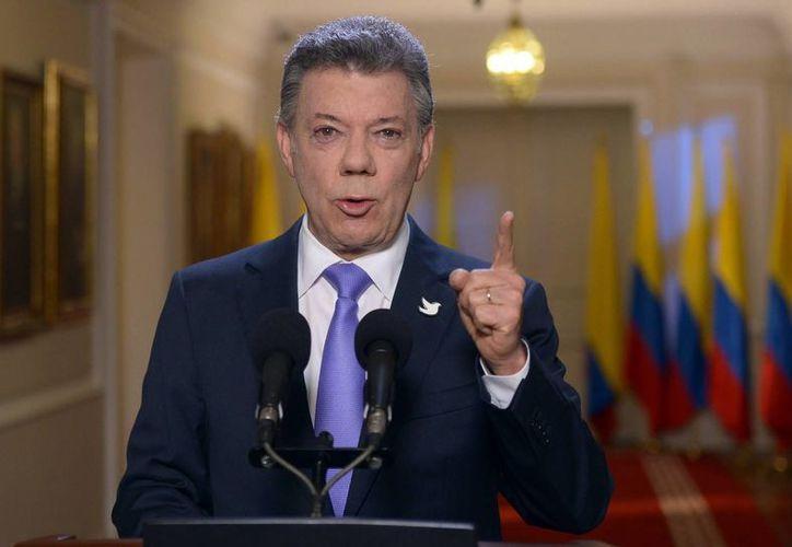 Juan Manuel Santos informó que el gobierno de Colombia considera denunciar a Venezuela ante la Corte Penal Internacional. (EFE)