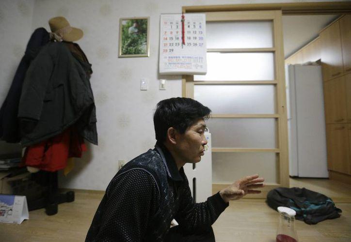 Li Yong-ho, asegura que prefiere trabajar 12 horas al día como chofer de camiones en Rusia que volver a Corea del Norte. (Agencias)