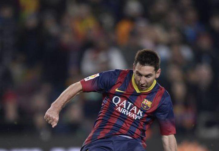 Messi dispara y mete uno de sus goles al Getafe. No anotaba desde noviembre del año pasado, cuando una lesión le amargó el fin de año. (Agencias)