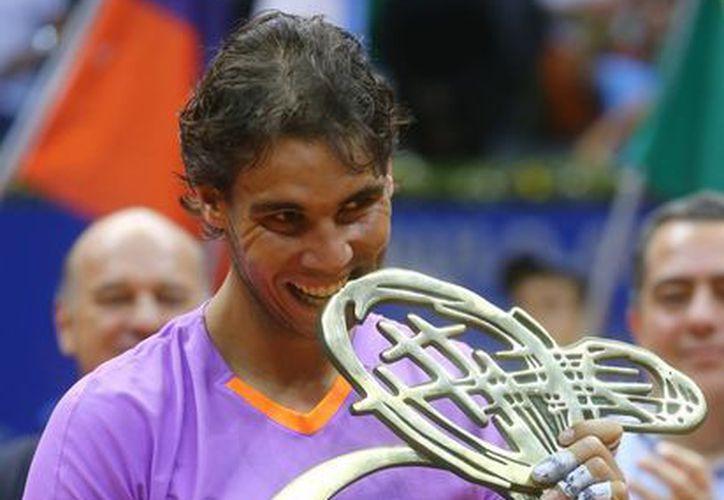 Nadal levantó su 51 título en el Abierto de Brasil. (AP)