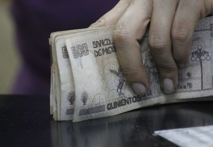 """La ley conocida como """"antilavado de dinero"""" carece de claridad para las compañías. (Israel Leal/SIPSE)"""