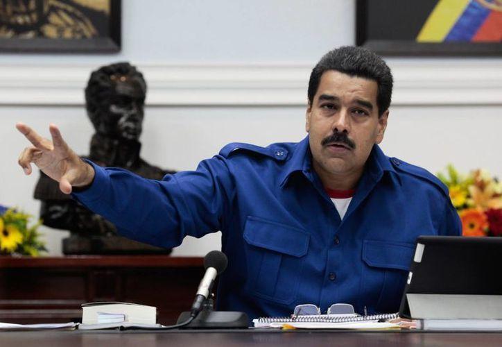 Nicolás Maduro cumplirá este 19 de marzo la mitad de su mandato de seis años, lo cual permite activar el referéndum revocatorio siempre y cuando se reúnan el 20 por ciento de las firmas del registro electoral. (Archivo/AP)