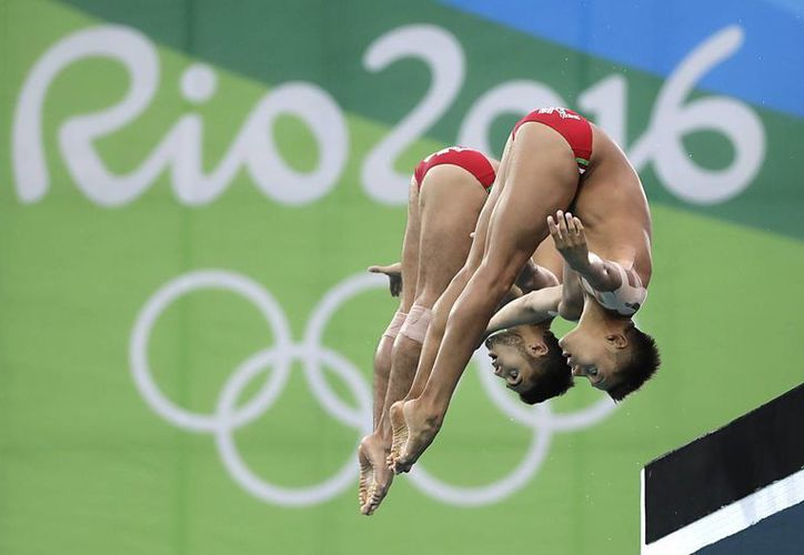 La dupla mexicana no pudo revalidar la medalla de plata que conquistaron en los Juegos Olímpicos de Londres 2012.(Wong Maye-E/AP)
