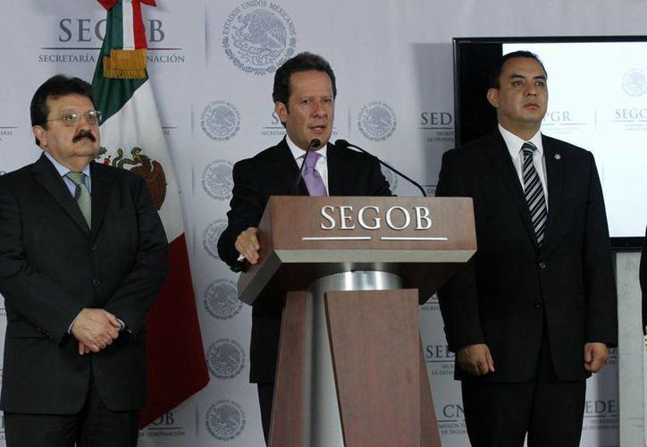 Los delincuentes son investigados por otros 50 plagios: Eduardo Sánchez (c). (Notimex)