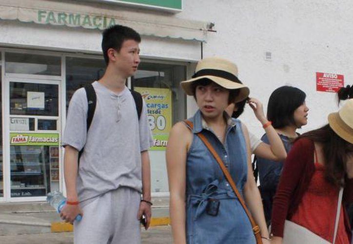 Los asiáticos son un segmento de turismo masivo, que actualmente viaja y gasta más que otros.  (Israel Leal/SIPSE)