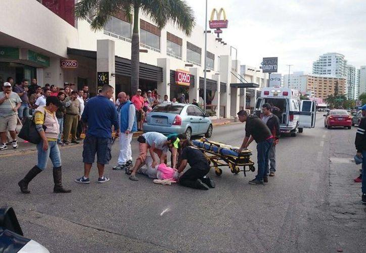 La visitante fue atropellada cuando intentó cruzar el bulevar Kukulcán. (Redacción)