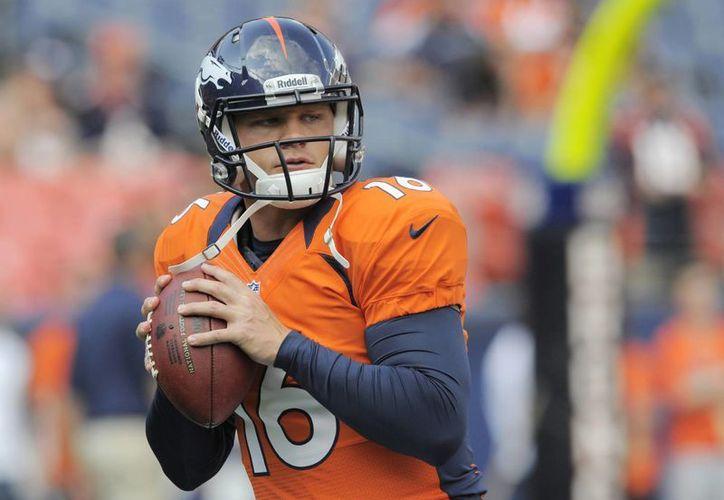 La nueva temporada de la NFL traerá algunos cambios en los horarios y fechas. En la foto Caleb Hanie, quarterback de Broncos de Denver.  (Foto de contexto de AP)